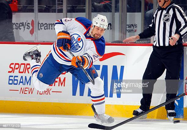 Matt Hendricks of the Edmonton Oilers in action against the New Jersey Devils at the Prudential Center on February 7 2014 in Newark New Jersey The...