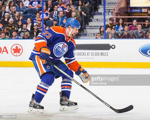 Matt Hendricks of the Edmonton Oilers skates against the Vancouver Canucks during an NHL game at Rexall Place on January 21 2014 in Edmonton Alberta...