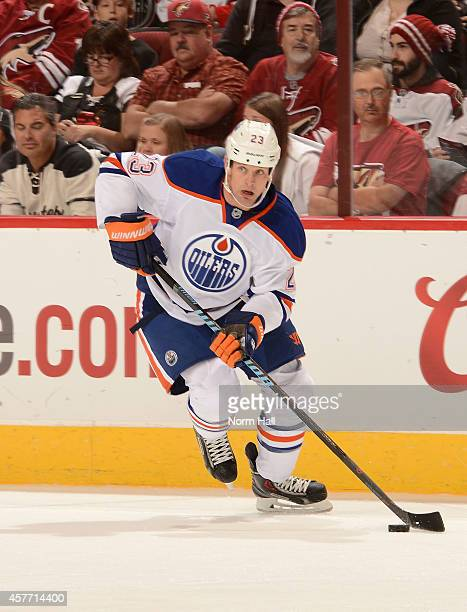 Matt Hendricks of the Edmonton Oilers skates the puck up ice against the Arizona Coyotes at Gila River Arena on October 15 2014 in Glendale Arizona