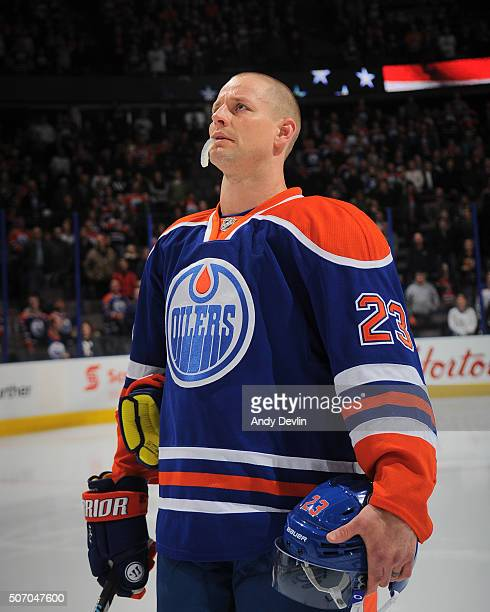 Matt Hendricks of the Edmonton Oilers stands for the singing of the national anthem prior to the game against the Carolina Hurricanes on January 4...