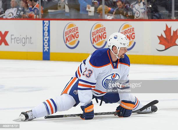 Matt Hendricks of the Edmonton Oilers stretches during the pregame warm up prior to NHL action against the Winnipeg Jets at the MTS Centre on January...