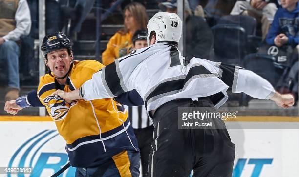 Matt Hendricks of the Nashville Predators fights Kyle Clifford of the Los Angeles Kings at Bridgestone Arena on December 28 2013 in Nashville...