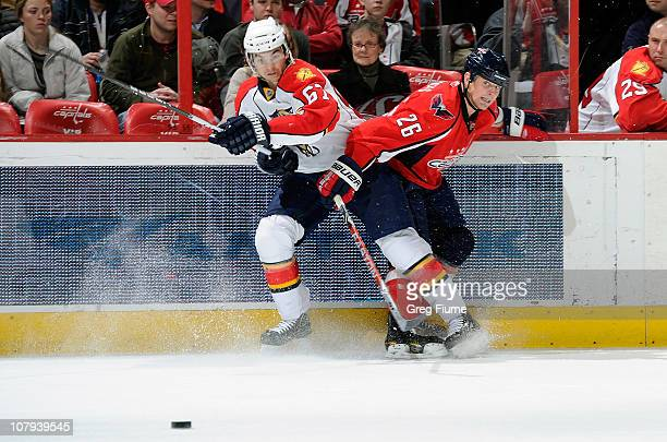 Matt Hendricks of the Washington Capitals battles for the puck against Michael Frolik the Florida Panthers at the Verizon Center on January 8 2011 in...
