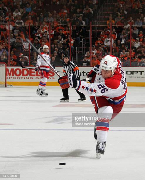 Matt Hendricks of the Washington Capitals breaks his stick while taking a shot against the Philadelphia Flyers at the Wells Fargo Center on March 22...