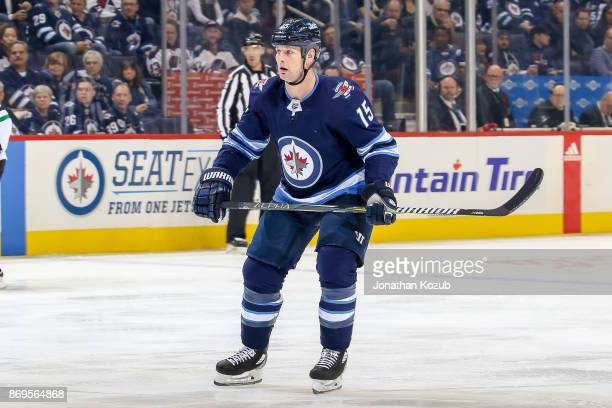 Matt Hendricks of the Winnipeg Jets follows the play down the ice during first period action against the Dallas Stars at the Bell MTS Place on...