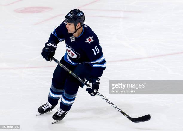 Matt Hendricks of the Winnipeg Jets keeps an eye on the play during third period action against the Vancouver Canucks at the Bell MTS Place on...