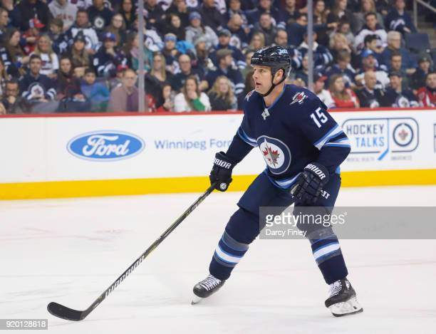 Matt Hendricks of the Winnipeg Jets keeps an eye on the play during second period action against the Washington Capitals at the Bell MTS Place on...