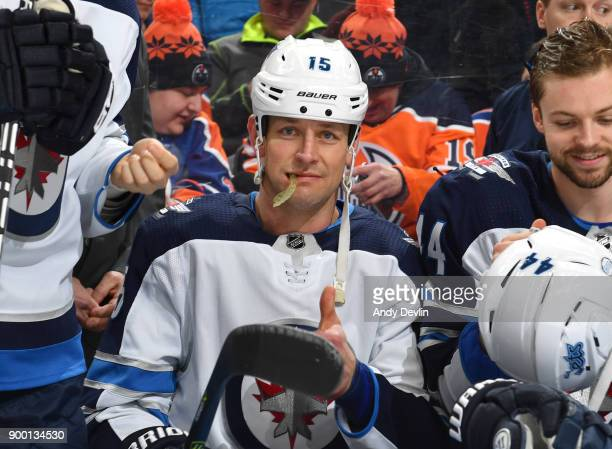 Matt Hendricks of the Winnipeg Jets sits on the bench prior to the game against the Edmonton Oilers on December 31 2017 at Rogers Place in Edmonton...