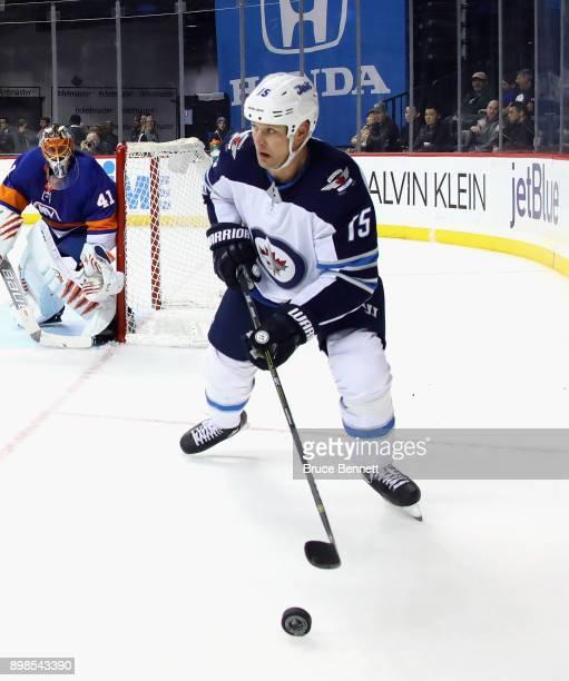 Matt Hendricks of the Winnipeg Jets skates against the New York Islanders at the Barclays Center on December 23 2017 in the Brooklyn borough of New...