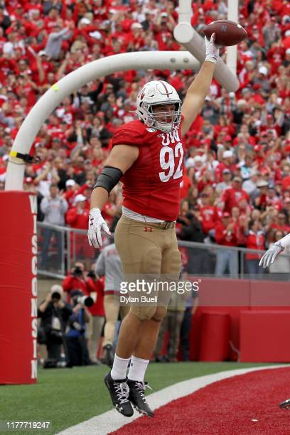 Matt Henningsen of the Wisconsin Badgers celebrates after scoring a touchdown in the third quarter against the Northwestern Wildcats at Camp Randall...