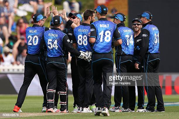 Matt Henry and Adam Milne of New Zealand celebrate the wicket of Azhar Ali of Pakistan during the One Day International match between New Zealand and...