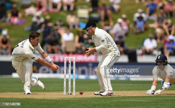 Matt Henry and Tom Latham of New Zealand fail to run out Rory Burns of England during day 3 of the second Test match between New Zealand and England...