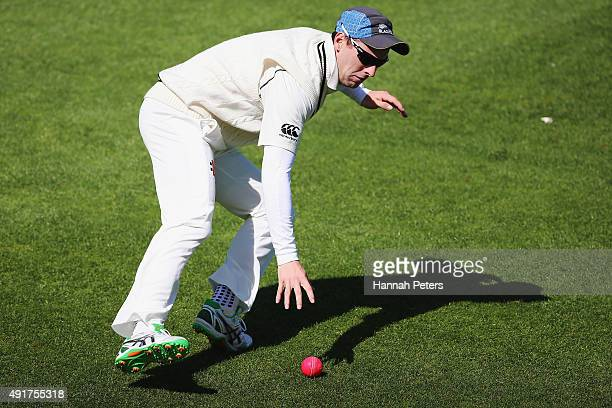 Matt Henry gathers the new pink cricket ball during a New Zealand cricket training session at Seddon Park on October 8, 2015 in Hamilton, New...