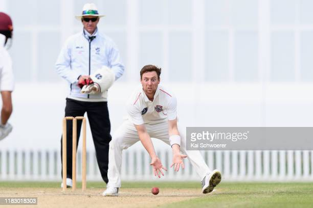 Matt Henry of Canterbury fields the ball off his own bowling during the Plunket Shield match between Canterbury and Northern Districts at Hagley Oval...