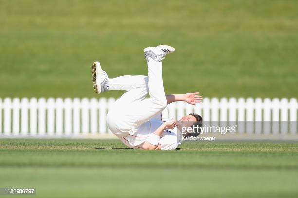 Matt Henry of Canterbury stumbles while bowling during the Plunket Shield match between Canterbury and Northern Districts at Hagley Oval on October...