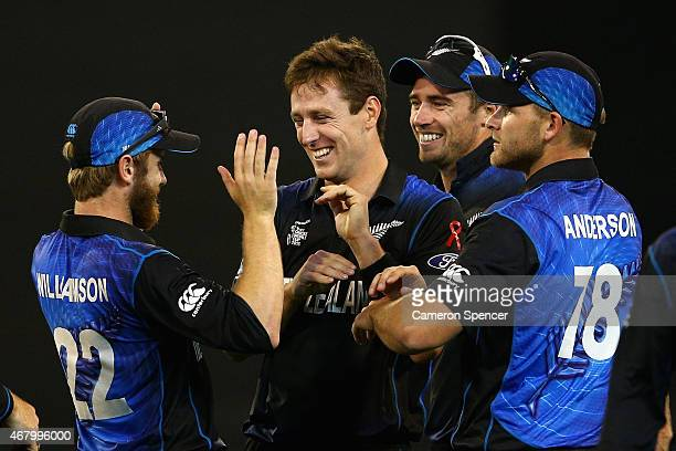 Matt Henry of New Zealand celebrates dismissing David Warner of Australia during the 2015 ICC Cricket World Cup final match between Australia and New...