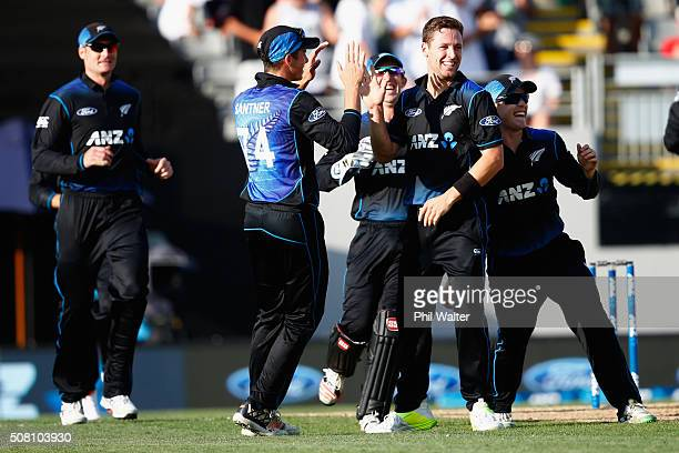 Matt Henry of New Zealand celebrates his wicket of George Bailey of Australia during the One Day International match between New Zealand and...