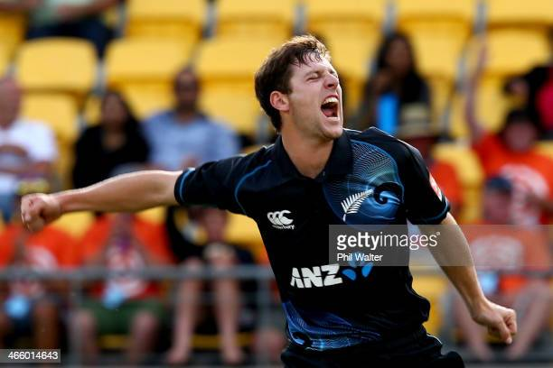 Matt Henry of New Zealand celebrates his wicket of Shikhar Dhawan of India during Game 5 of the men's one day international between New Zealand and...