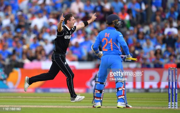 Matt Henry of New Zealand celebrates the wicket of Dinesh Karthik of India during resumption of the SemiFinal match of the ICC Cricket World Cup 2019...