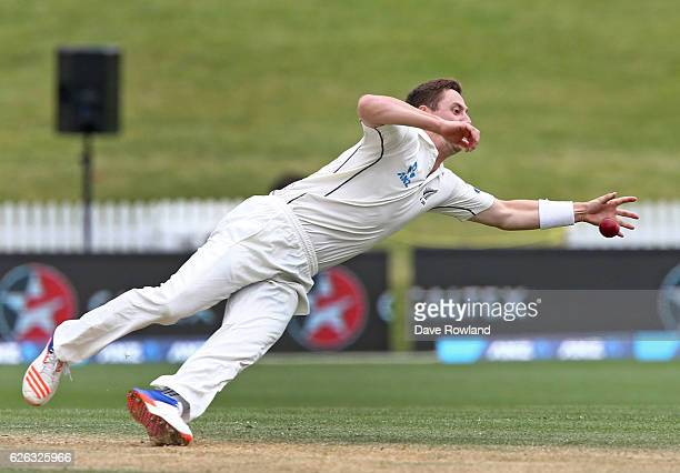 Matt Henry of New Zealand dives for the ball during day five of the Second Test match between New Zealand and Pakistan at Seddon Park on November 29...