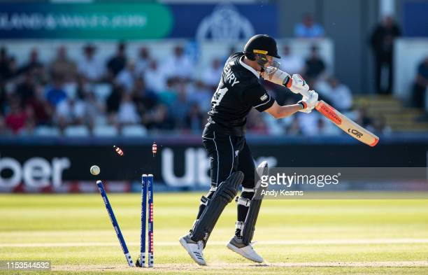 Matt Henry of New Zealand is bowled by Mark Wood of England during the Group Stage match of the ICC Cricket World Cup 2019 between England and New...