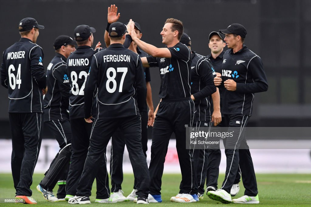 Matt Henry of New Zealand (C) is congratulated by team mates after dismissing Chris Gayle of the West Indies bowls during the One Day International match during the series between New Zealand and the West Indies at Hagley Oval on December 26, 2017 in Christchurch, New Zealand.
