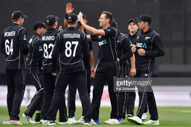 Matt Henry of New Zealand is congratulated by team mates after dismissing Chris Gayle of the West Indies bowls during the One Day International match...