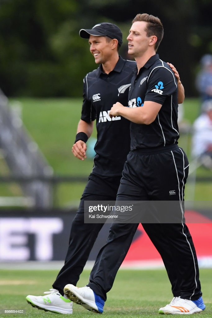 Matt Henry of New Zealand (R) is congratulated by Trent Boult of New Zealand after dismissing Chris Gayle of the West Indies bowls during the One Day International match during the series between New Zealand and the West Indies at Hagley Oval on December 26, 2017 in Christchurch, New Zealand.