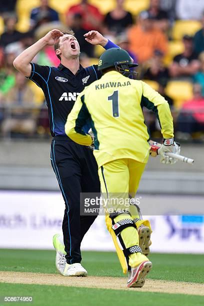 Matt Henry of New Zealand reacts to Usman Khawaja of Australia hitting a four during the 2nd oneday international cricket match between New Zealand...