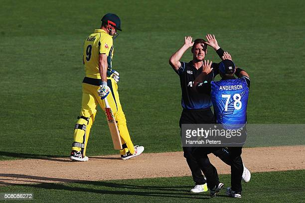 Matt Henry of the Black Caps celebrates the wicket of Shaun Marsh of Australia with Corey Anderson of the Black Caps during the One Day International...