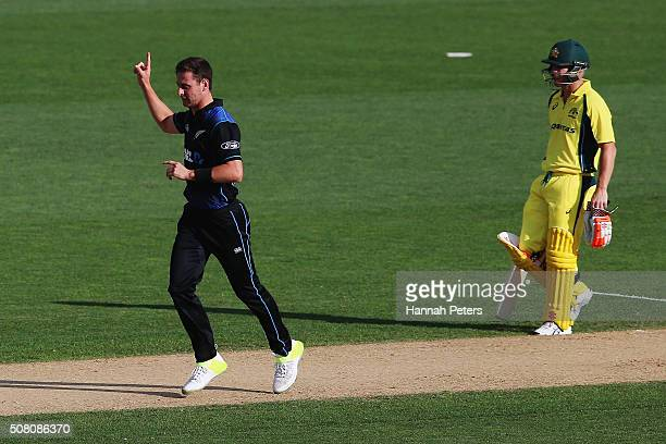 Matt Henry of the Black Caps celebrates the wicket of Shaun Marsh of Australia during the One Day International match between New Zealand and...