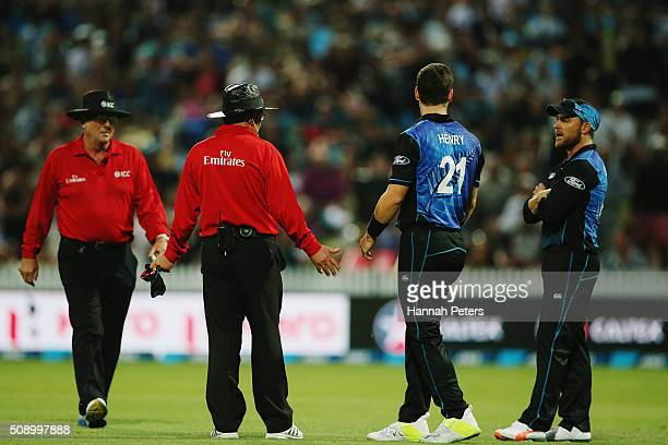 Matt Henry of the Black Caps talks to Brendon McCullum about reviewing the wicket of Mitchell Marsh of Australia during the 3rd One Day International...