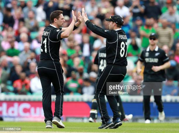 Matt Henry the New Zealand bowler celebrates with team mate Lockie Ferguson after taking the wicket of MD Mithun of Bangladesh pulls the ball to the...