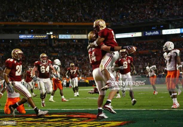 Matt Henshaw and James Coleman of the Florida State Seminoles celebrate a touchdown against the Miami Hurricanes during the Orange Bowl January 1...