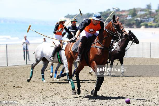 Matt Hitchman attacks during the 2018 Takapuna Beach Polo on December 15 2017 in Auckland New Zealand