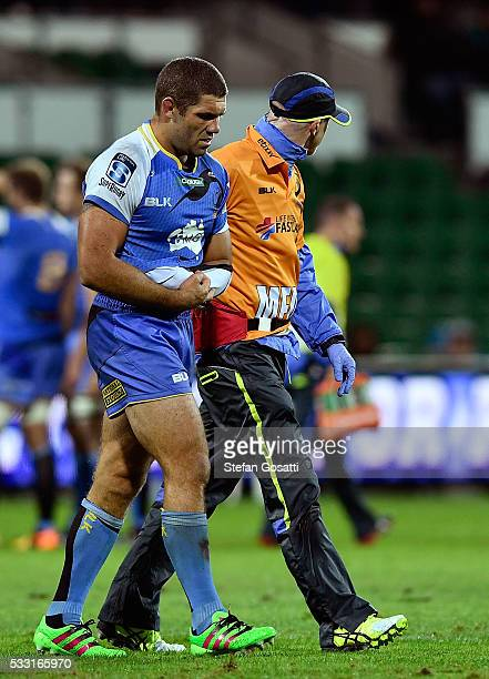 Matt Hodgson of the Force leaves the ground after injuring his shoulder during the round 13 Super Rugby match between the Force and the Blues at nib...