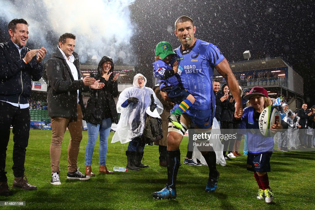 Matt Hodgson of the Force runs onto the field with his children Buddy and Hunter to play his final game during the round 17 Super Rugby match between the Force and the Waratahs at nib Stadium on July 15, 2017 in Perth, Australia.