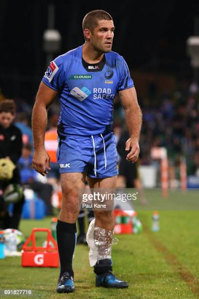 Matt Hodgson of the Force walks to the changerooms after being substituted out of the game during the round 15 Super Rugby match between the Force...