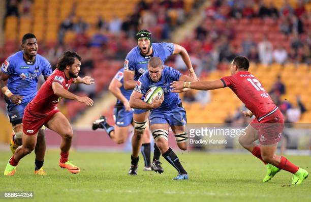 Matt Hodgson of the Western Force breaks through the defence during the round 14 Super Rugby match between the Reds and the Force at Suncorp Stadium...