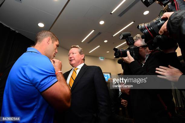 Matt Hodgson speaks with Andrew Forrest before moving address the cameras during a press conference at Rugby WA HQ on September 5 2017 in Perth...