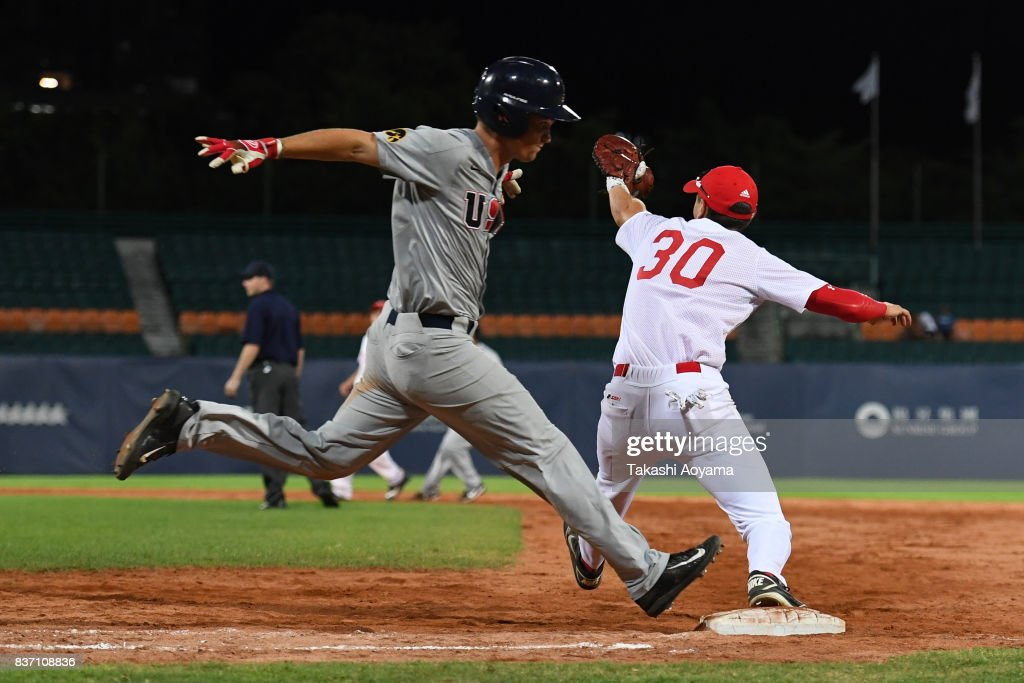 Matt Hoeg #3 of United States is safe at first base on an infield single in the forth inning during the Baseball Group B match between United States and Russia during day three of the 29th Summer Universiade Taipei at the Xinzhuang Baseball Stadium on August 22, 2017 in Taipei, Taiwan.