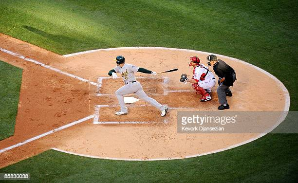 Matt Holiday of the Oakland Athletics get his first hit as an A against the Los Angeles Angels of Anaheim at the Angel Stadium of Anaheim on April 6...