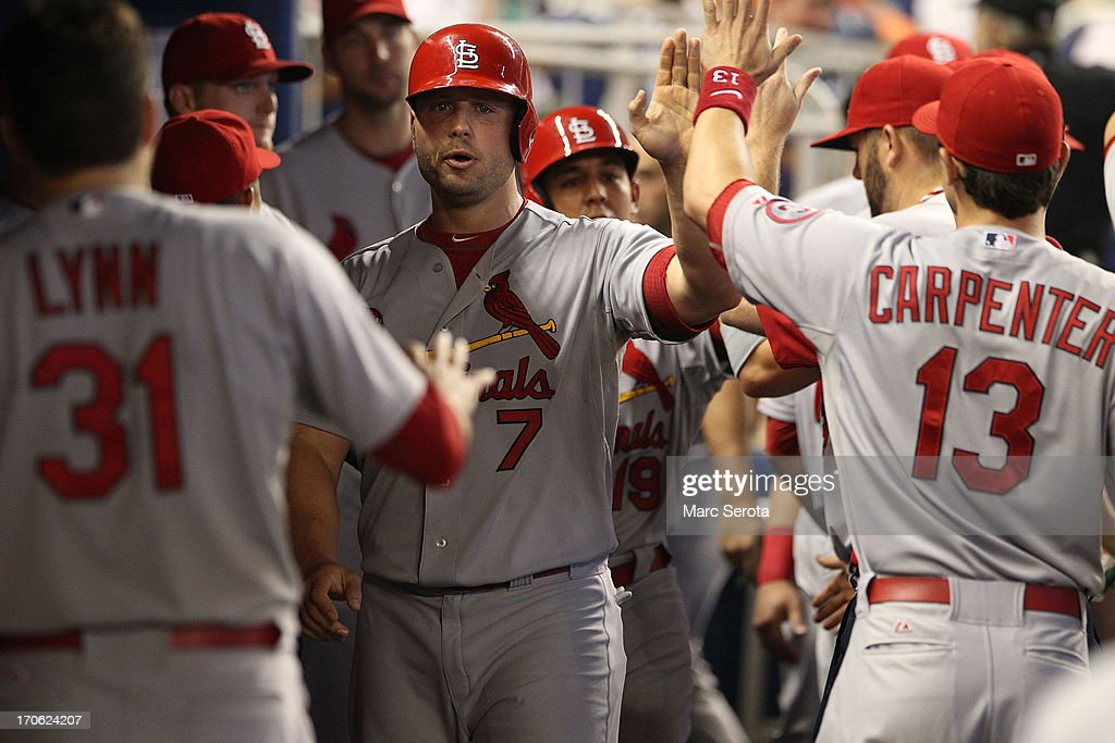 Matt Holiday #7 of the St. Louis Cardinals celebrates with teamates against the Miami Marlins during the first inning at Marlins Park on June 15, 2013 in Miami, Florida.