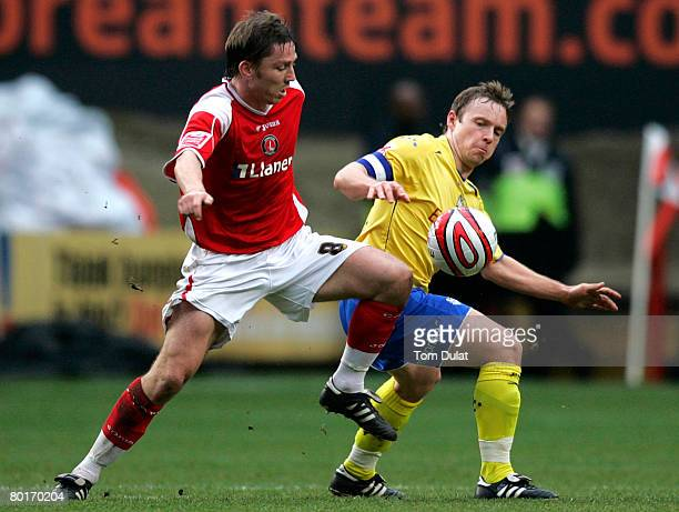 Matt Holland of Charlton Athletic battles for the ball with Paul McKenna of Preston North End during the Coca Cola Championship match between...