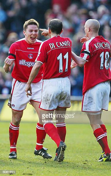 Matt Holland of Charlton Athletic celebrates scoring the first goal against Middlesbrough with Paolo Di Canio during the FA Barclaycard Premiership...