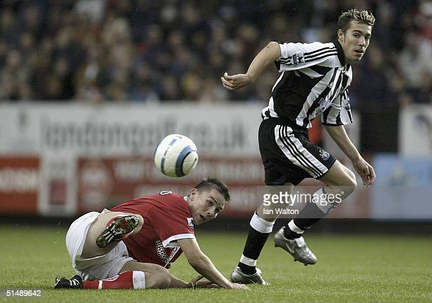 Matt Holland of Charlton Athletic tries to tackle Darren Ambrose of Newcastle United during the Barclays Premiership match between Charlton Athletic...