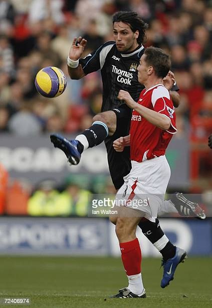 Matt Holland of Charlton Athletic tries to tackle Georgios Samaras of Manchester City during the Barclays Premiership match between Charlton Athletic...