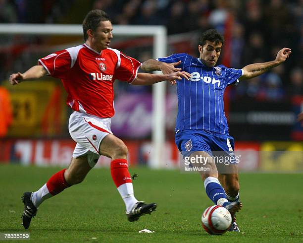 Matt Holland of Charlton Athletic tries to tackle Pablo Counago of Ipswich Town during the Coca-Cola Championship match between Charlton Athletic and...