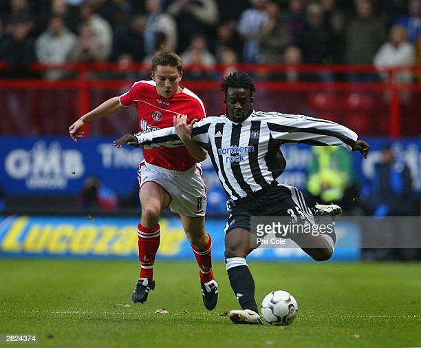 Matt Holland of Charlton tackles Olivier Bernard of Newcastle during the FA Barclaycard Premiership match between Charlton Athletic and Newcastle...
