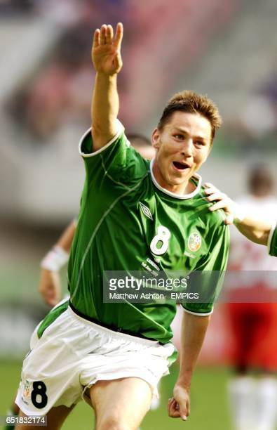 Matt Holland of Ireland celebrates after scoring the equalising goal against Cameroon